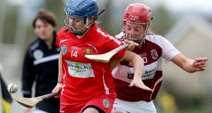 Cork's Rachel O'Callaghan and Westmeath's Maeve Scally battle it out in the Littlewoods Ireland Camogie League 2 final. Photograph: Bryan Keane/Inpho