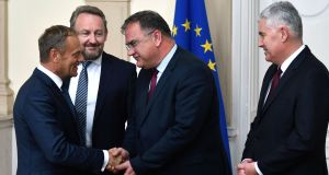 European Council president Donald Tusk (left) on an official visit to Bosnian capital Sarajevo last Thursday shaking hands with members of Bosnia and Herzegovina's tripartite presidency: Bakir Izetbegovic, Dragan Covic and Mladen Ivanic. Photograph:   Elvis Barukcic/AFP/Getty Images