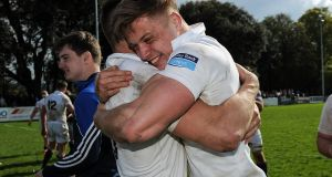 Cork Constitution's Liam O'Connell and Alex McHenry celebrate after their win over Terenure College in the Ulster Bank League Division 1A Semi-Final. Photograph: Tommy Grealy/Inpho