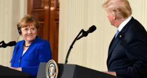 German chancellor Angela Merkel said she had spoken to Emmanuel Macron and  Theresa May since returning from her Friday talks in Washington with Donald Trump. Photograph: Susan Walsh/AP Photo