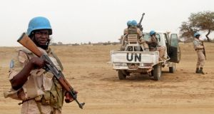 United Nations peacekeepers stand guard in the northern Mali town of Kouroume. Photograph: Adama Diarra/Reuters