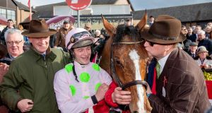 Trainer Willie Mullins, jockey David Mullins and owner Rich Ricci celebrate after winning the Ladbrokes  Champion Stayers Hurdle  with Faugheen at Punchestown on Thursday. Photograph: Morgan Treacy/Inpho