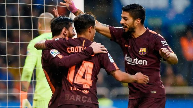 Lionel Messi celebrates with Philippe Coutinho and Luis Suarez at the Riazor stadium in Coruna. Photograph: Getty Images