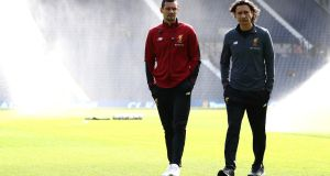 Dejan Lovren with Liverpool assistant manager Zeljko Buvac at The Hawthorns. Photograph: Matthew Lewis/Getty Images