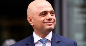 Sajid Javid stands outside the Home Office after being named home secretary. Photograph: REUTERS/Toby Melville