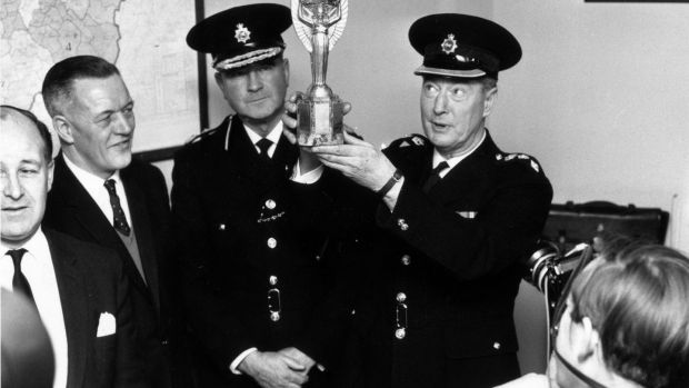 Chief Superintendent William Gilbert lifts the Jules Rimet trophy on March 28th 1966. Photograph: Central Press/Getty