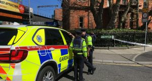 Gardaí at a cordoned off Sherriff Street after suspected explosive material was found near Connolly station