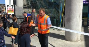 Irish Rail staff speak to passengers at the  blocked entrance to Connolly train station on Monday afternoon. Photograph: Peter Murtagh
