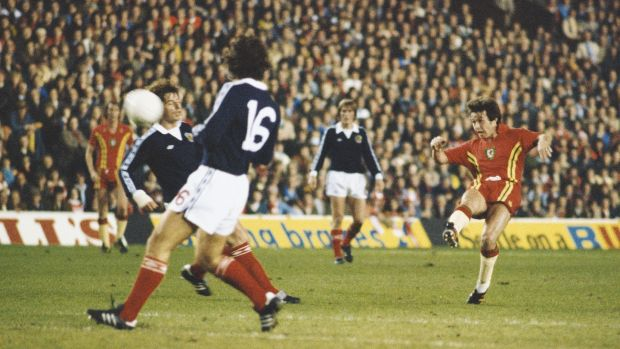 Brian Flynn gets a shot away during the 1978 qualifier between Wales and Scotland at Anfield. Photograph: Allsport/Getty Images