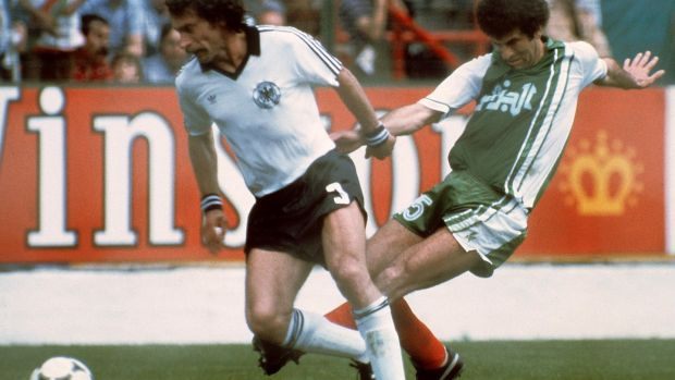 West German defender Paul Breitner under pressure from Algerian midfiedler Mustapha Dahleb. Photograph: Staff/Getty