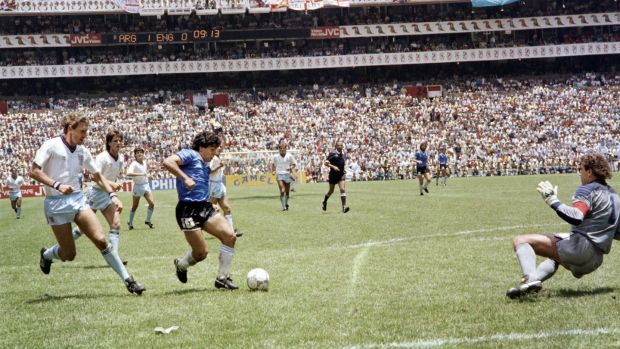 Diego Maradona goes past Peter Shilton on his way to scoring the second goal. Photograph: Getty Images