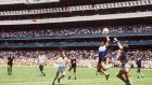 Diego Maradona   handles the ball past Peter Shilton of England to score