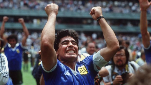 Diego Maradona celebrates at the end of the match. Photograph: Billy Stickland/Inpho