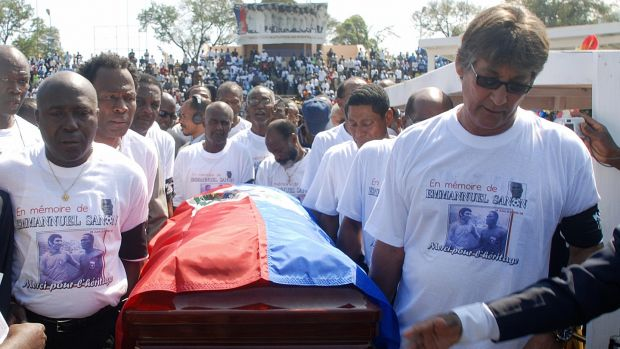 Former Haitian national soccer players Philippe Vorbes (R) and Tom Pouce (L) carry the casket of their teammate Emmanuel Sanon on March 5th, 2008. Photograph: Thony Belizaire/AFP