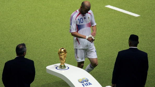 Zidane walks past the World Cup trophy after getting a red card for head-butting Materazzi. Photograph: Getty Images