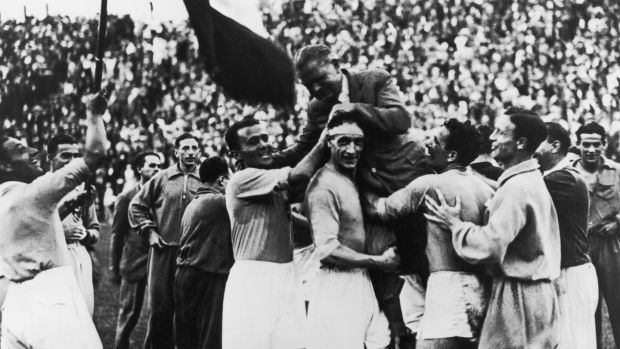 The Italian World Cup winners carry manager Vittorio Pozzo after their 2-1 victory over Czechoslovakia. Photograph: Keystone/Getty