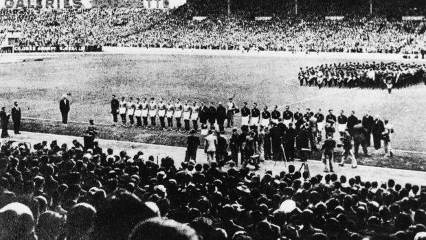 The Italian and Hungarian football teams line-up ahead of the 1938 World Cup final. Photograph: Hulton archive/Getty
