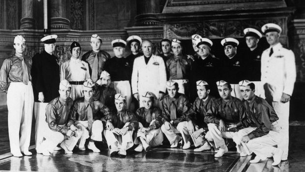 Duce Benito Mussolini (C, in white) with Italy's 1938 World Cup winners. Photograph: Staff/AFP