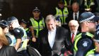 Cardinal George Pell (76) leaves Melbourne Magistrates Court on Tuesday. The cardinal had always denied the allegations against him, but today was the first time he had been required to enter a formal plea. Photograph: Joe Castro/EPA
