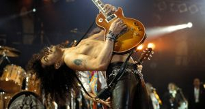 Slash playing a Gibson Les Paul   at the Freddie Mercury Tribute Concert,  Wembley Stadium, London in 1992.  Photograph: Mick Hutson/Redferns