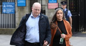 Linda Hussey Smith and Gordon Smith (Light blue shirt)  leaving the Four Courts on Tuesday escorted by gardaí. Photograph: Collins Courts