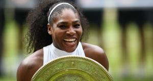 Serena Williams poses with the winner's trophy at  the 2016 Wimbledon Championships. Photograph:  Glyn Kirk/AFP/Getty Images