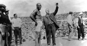 Jack Johnson on July 4th, 1910, before his successful title defense against ''The Great White Hope'' James J. Jeffries in Reno, Nevada. Donald Trump has said that he may offer the former world champion a full pardon. Photo: Sporting News/Sporting News via Getty Images