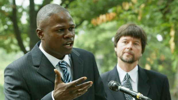 Boxer Vernon Forrest speaks while documentary filmmaker Ken Burns looks on during a media conference to discuss a legal petition seeking a posthumous presidential pardon for former boxer Jack Johnson on Capitol Hill in 2004. Photo: Alex Wong/Getty Images