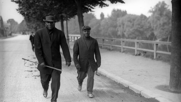 Jack Johnson, left in Paris in 1914. Photo: Topical Press Agency/Getty Images
