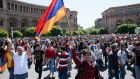 Armenian opposition supporters walk on the street after protest movement leader Nikol Pashinyan announced a nationwide campaign of civil disobedience in Yerevan on Wednesday. Photograph: Gleb Garanich/Reuters