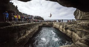 The Serpent's Lair during the first stop of the Red Bull Cliff Diving World Series  on Inis Mór, Ireland. Photograph:  Dean Treml/Red Bull via Getty Images