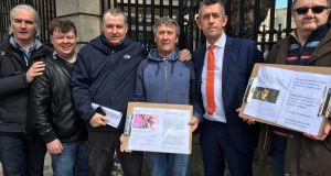 John Allen (third from left) and other members of campaign group for victims of  school child abuse, outside Leinster House. They are joined by  Sinn Féin TD Maurice Quinlivan (second from right).