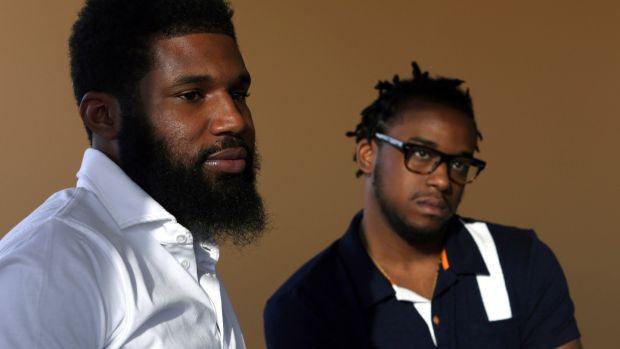 Rashon Nelson, left, and Donte Robinson: arrested at a local Starbucks. Photograph: Jacqueline Larma/AP