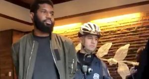 Rashon Nelson is held by police  inside a Starbucks cafe in Philadelphia, Pennsylvania. File Photograph: Reuters