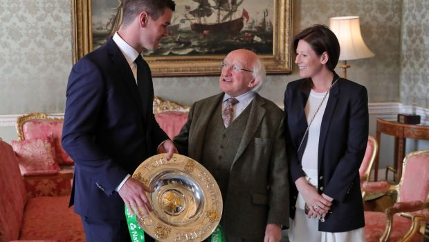 Johnny Sexton and his wife Laura pictured with President Michael D Higgins and the Triple Crown trophy. Photograph: Colin Keegan