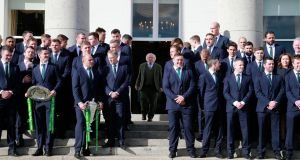 President Michael D Higgins walks out to greet the Ireland team, staff and partners at  Áras an Uachtaráin on Wednesday. Photograph: Nick Bradshaw