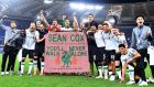 Liverpool players celebrate with a banner supporting Irish Liverpool fan Seán Cox who was severly injured before  the first-leg match at Anfield. Photograph:  Ettore Ferrari/EPA