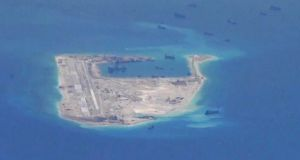 Chinese dredging vessels are purportedly seen in the waters around Fiery Cross Reef in the disputed Spratly Islands in the South China Sea in this still image from video taken by a P-8A Poseidon surveillance aircraft provided by the US Navy. Photograph: US Navy handout via Reuters.
