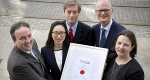 Dr Junsi Wang (second from left) receiving the Royal Irish Academy Young Chemist Prize for 2017 with (from left) Dr Matthew Holloway of Henkel Global (award sponsors), Prof Pat Guiry, science secretary at RIA, Prof Peter Kennedy, RIA president, and Prof Sylvia Draper of TCD. Photograph: Johnny Bambury