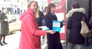 Minister for Culture, Heritage and the Gaeltacht Josepha Madigan (right) with Senator Catherine Noone, handing out Vote Yes leaflets to commuters outside Pearse Street Station in Dublin. Photograph: Laura Paterson/PA Wire
