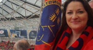 Carmel Breen, before her illness, supports Munster at a rugby match.