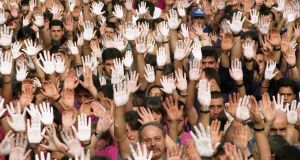 In this file photo taken on July 25th, 1997, demonstrators show their hands painted white, during a protest in Ermua against Popular Party (PP) councillor Miguel Angel Blanco's death, at the hands of armed Basque group ETA. Photograph: Rafa Rivas/AFP/Getty Images