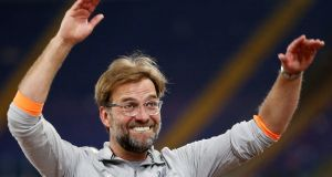 Jürgen Klopp thanks the Liverpool fans after reaching the Champions League final at the Stadio Olimpico, Rome.Photograph: Steven Paston/PA Wire