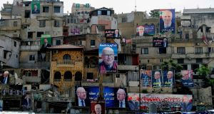 Election posters  on buildings in the Bab al-Tabbaneh and Jabal Mohsen neighbourhoods of Tripoli in  northern Lebanon. Photograph: Getty Images