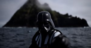 My dominion: A Star Wars fan dressed in costume as Darth Vader on a boat trip to Skellig Michael  during the inaugural 'May The 4th Be With You' festival in the Co Kerry village of Portmagee. Photograph: Clodagh Kilcoyne/Reuters