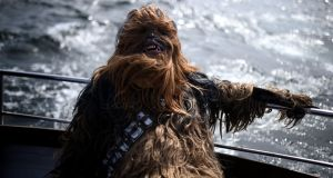 A Star Wars fan dressed as Chewbacca, suffering seasickness on a boat trip to Skellig Michael during the inaugural May The 4th Be With You festival in the Co Kerry village of Portmagee, Ireland. Photograph: Clodagh Kilcoyne/Reuters