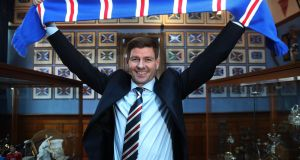 "Steven Gerrard shakes  is unveiled as the new manager of Rangers  at Ibrox Stadium on Friday: ""I have confidence I can deliver here as a manager."" Photograph:    Ian MacNicol/Getty Images"
