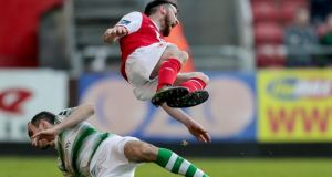 St Patrick's Athletic's Ryan Brennan is tackled by Joey O'Brien of Shamrock Rovers during the SSE Airtricity League Premier Division match at  Richmond Park. O'Brien was shown a red card. Photograph: Laszlo Geczo/Inpho