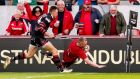 Keith Earls goes over for a try for Munster in their Pro14 semi-final qualifier win over Edinburgh. Photo: Billy Stickland/Inpho