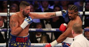 Tony Bellew delivers a straight left against David Haye at the O2 Arena in London. Photograph: Getty Images